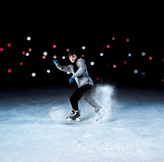 Boy ice skating at Aotea Square Ice Rink