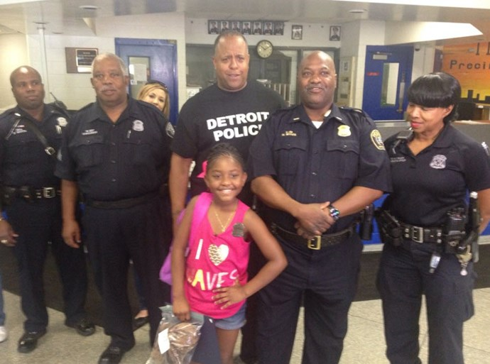 Little girl with police