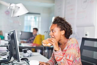 Woman eating lunch in her office