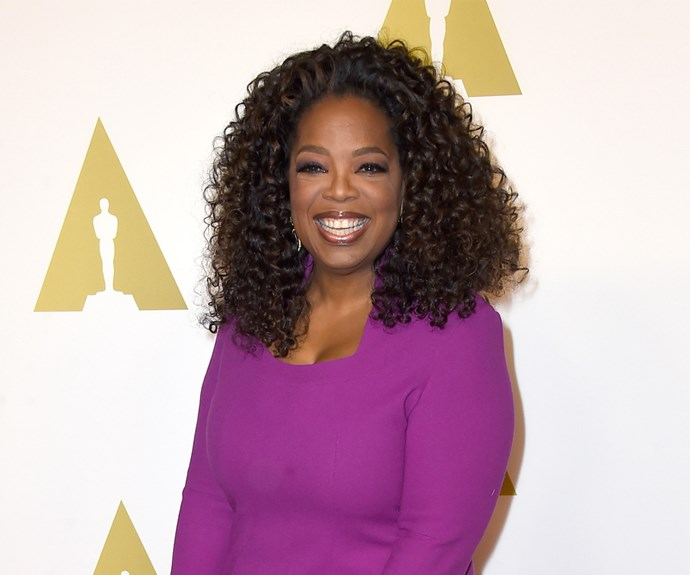 That's the Oprah we know and love! These days she keeps to the tried and tested lengthy curls with red highlights. Perfection!