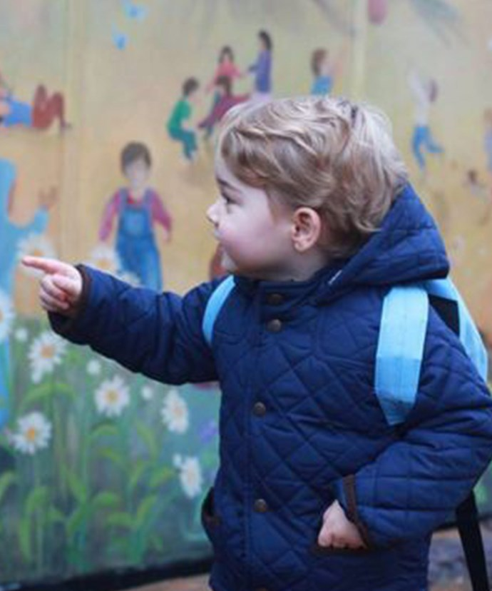 Prince George was captivated by his new school's brightly-coloured mural.
