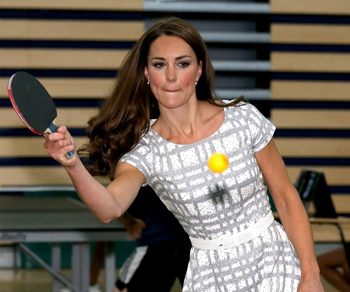 **Giving it her all:** The mother-of-two's ping pong concentration face was on point during a visit to London's Bacon's College in 2012.