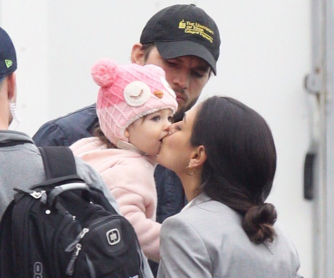 Kisses for a cutie! Mila was showering her daughter with love.