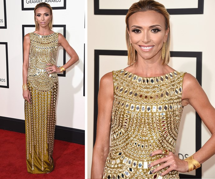 Golden girl! *E!* host Giuliana Rancic dazzled in an embellished floor-length gown by Jani & Khosla which she teamed with slicked-back hair.