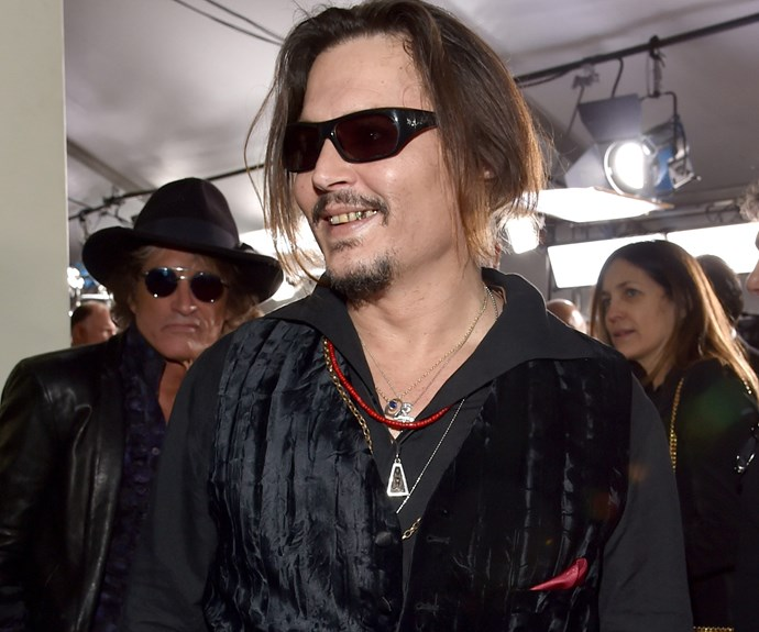 Johnny Depp covered up in a pair of sunglasses.