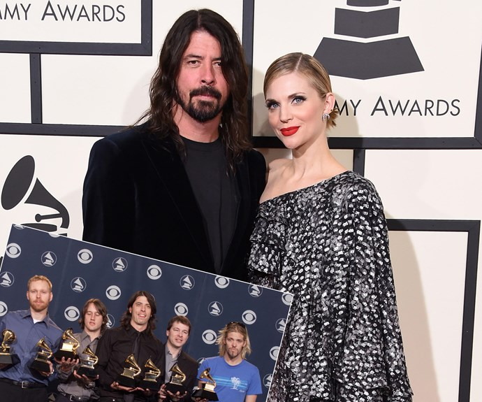 Dave Grohl was joined by his wife. Inset, the Foo Fighters posed backstage with Grammys they received for Best Rock Album and Best Music Video/Short Form at the 43rd Annual Grammy Awards at Staples Center in Los Angeles back in 2001.