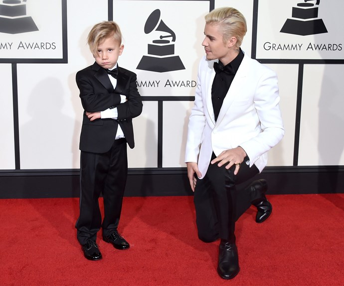 Biebs looked very entertained as his younger sibling posed up a storm on the red carpet.