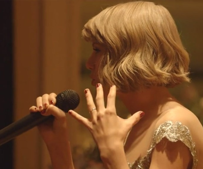 There it is! The gold band sat in plain sight as Taylor toasted to her best friend's happiness at her wedding last week.