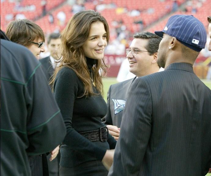 Awkward... Katie Holmes and ex-hubby Tom Cruise chat with Jamie Foxx on the sidelines before a sports game in 2006.