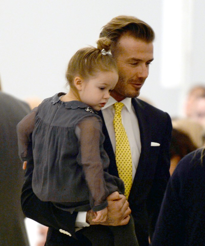David Beckham pictured with his daughter Harper, 4, at Victoria Beckham's Fashion Week show.