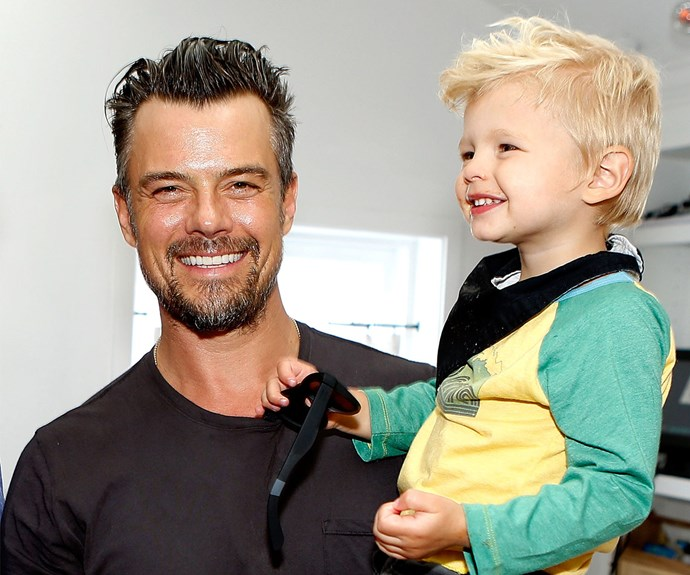 """Those smiles! Back in March, hearts exploded when Josh and Axl attended a charity event to help save sea turtles in LA. """"He loves costumes - fireman, space man, Power Rangers. He's just a rowdy little boy,"""" the proud dad told *E! News* of his two-year-old son."""
