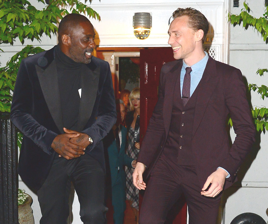 Look who we spy staring longingly at Tom as he leaves a private event with Idris Elba. WEEKS before she split with Calvin