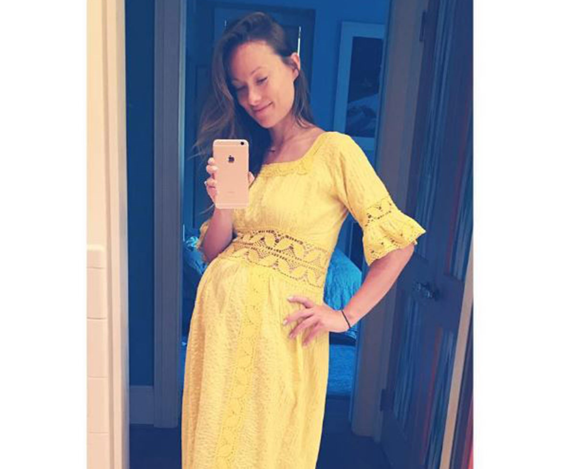 """""""What to do when you look like Homer Simpson ate Little Miss Sunshine? Chill the f out. They're both heroes,"""" the hilarious actress joked. This sunshine-yellow vintage frock perfectly shows off her gorgeous belly."""