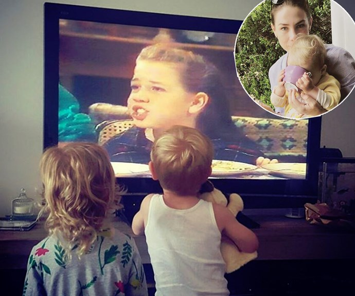 """Too cute! This super sweet moment of two-year-old Mae watching her mummy's vintage re-runs of *Home and Away* has us smiling from ear to ear. """"Watching old videos at Nanny's house.. #ImSureTheydPreferPlaySchool #ThatsMyMummy #HomeAndAway,"""" Kate Ritchie shared."""