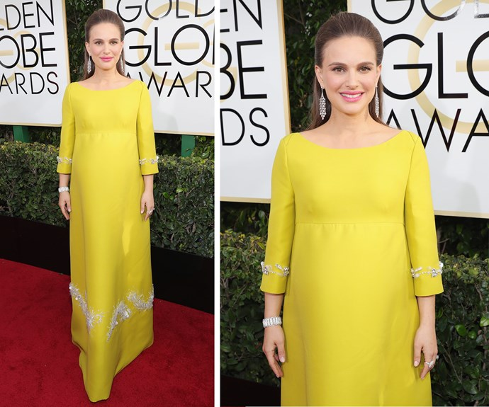 *Jackie* star Natalie Portman, who is pregnant with her second child, wows in a bright yellow Prada dress and vintage Tiffany jewellery from 1910.