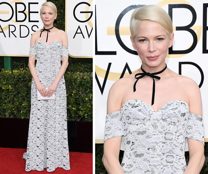 Michelle Williams dared to bare her shoulders in a Louis Vuitton dress, which she teamed with a black choker.