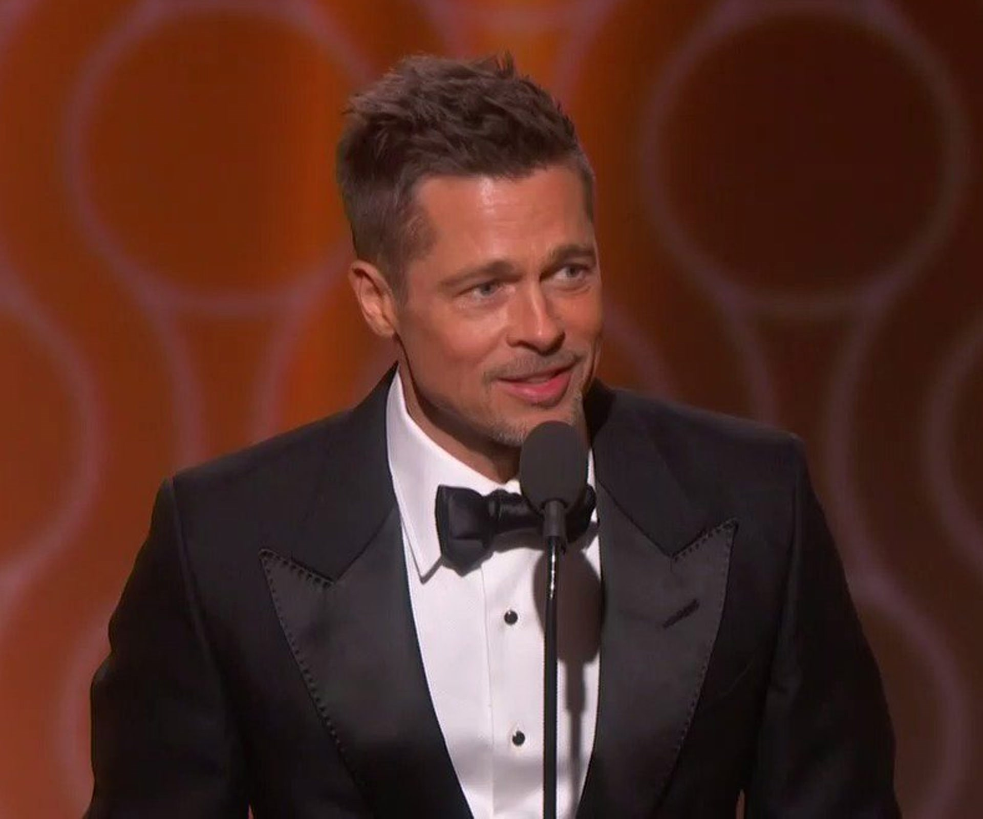 Brad Pitt looked better than ever as he took to the stage to present the Best Motion Picture - Comedy or Musical award, which went to *La La Land*. The audience were delighted by the newly single actor's surprise appearance and cheered him on.