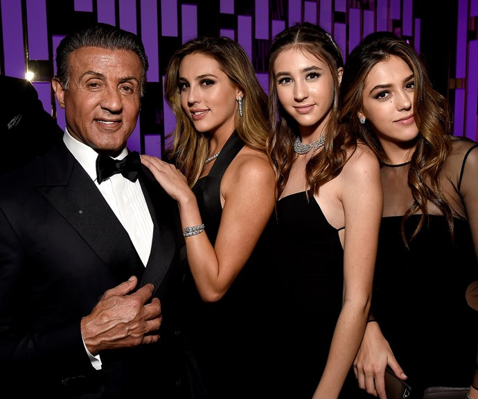 "Sylvester Stallone with his golden girls, Sistine, 18, Scarlet, 14, and Sophia, 20, who worked as [Golden Globes girls during the ceremony.](http://www.womansday.com.au/style-beauty/red-carpet/sylvester-stallones-daughters-to-be-miss-golden-globes-17532|target=""_blank"")"