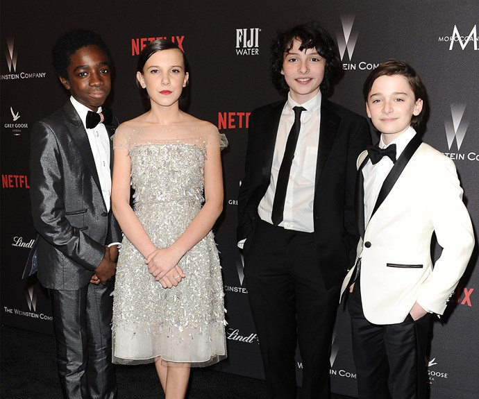 The cast of *Stranger Things* make their way into the *Netflix* after party.