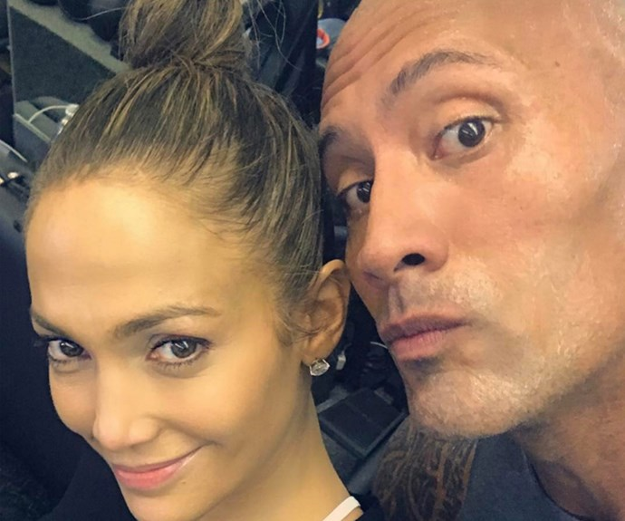 "Who knew Jennifer Lopez and Dwayne 'The Rock' Johnson were gym buddies? The mother-of-two recently took to Instagram with a happy snap after a sweat sesh with *People's* Sexiest Man Alive. ""Just a couple of gym rats gettin' it in!! @therock thanks for the love and for all the positive energy and inspiration you put out into the world!!"""