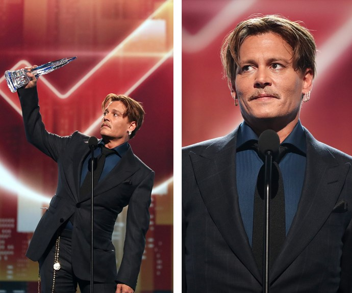 Johnny Depp raises his PCA high as he accepts the Favourite Movie Icon title.