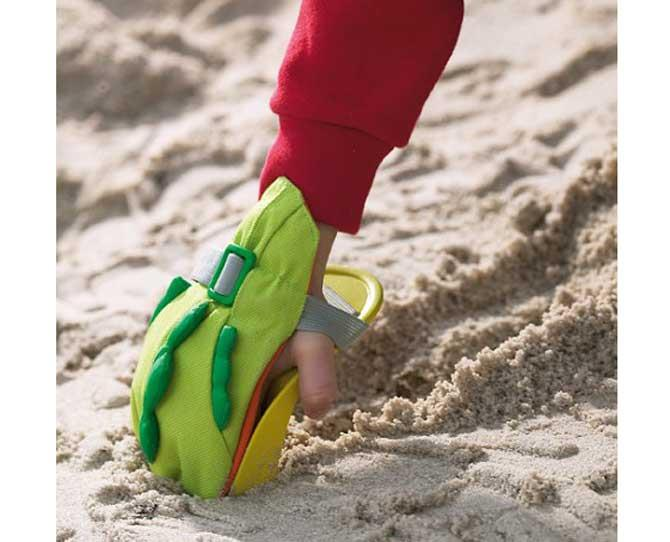 UNDER $25  If dinosaurs went to the beach and played in the sand, this is what it would look like...kinda. The Haba Digging Claw Beach Toy, $19.95, from Haggus & Stookles is just ace in so many ways!