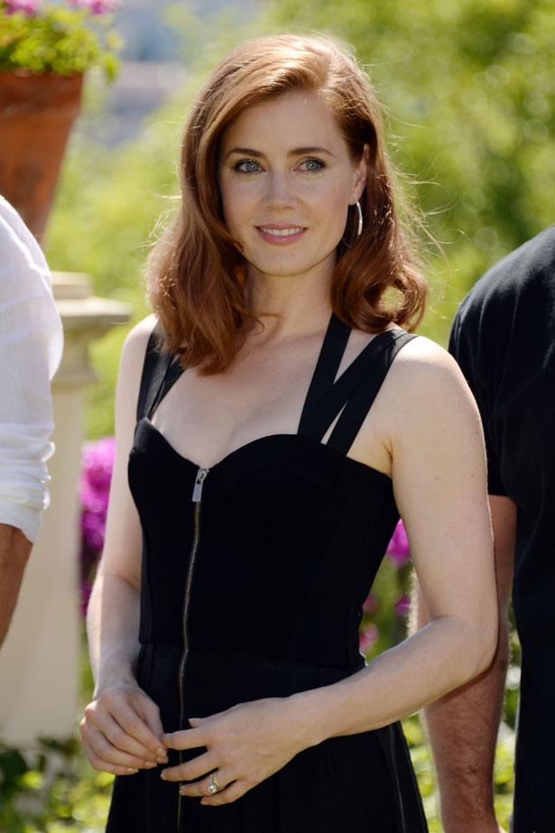 **Amy Adams** <br><br> Amy Adams' ever-glamorous locks can switch from light to dark red with ease. Get bouncy waves that last by curling and then pinning them in place until they cool.