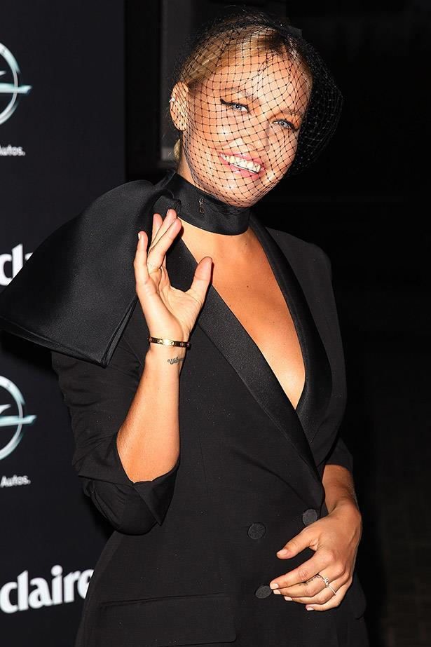 A top-to-toe black Dior red carpet look was given a dose of glam with a silk necktie. Fashion props Lara Bingle.