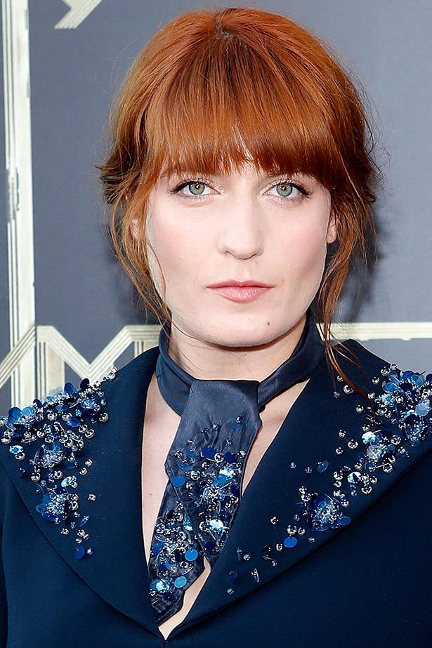Hot off the runway, Florence Welch was radiant on the red carpet in an embellished Miu Miu necktie and outfit.