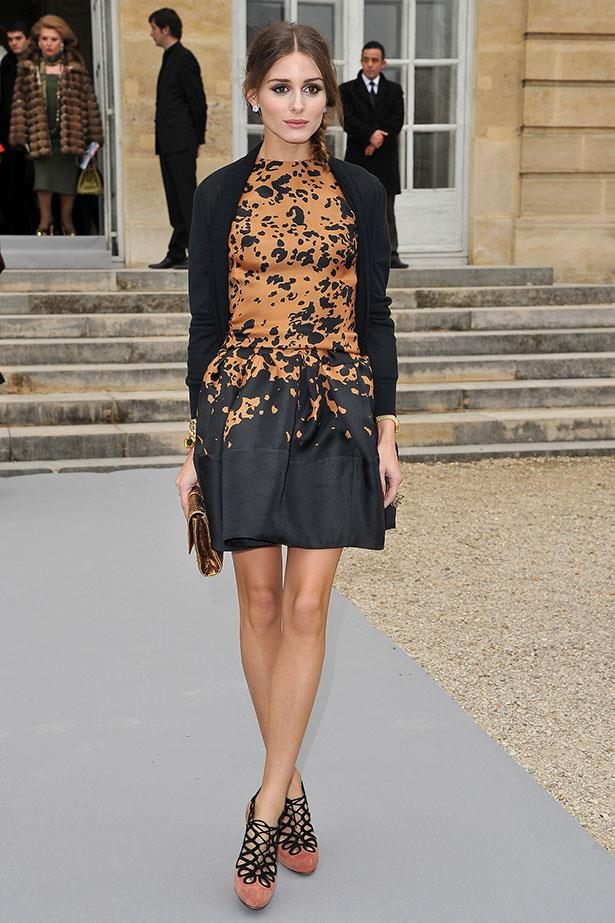 Palermo mastered a busy copper-tone print dress by pairing it with intricate heels and an understated metallic clutch at Christian Dior's AW12 show in Paris.
