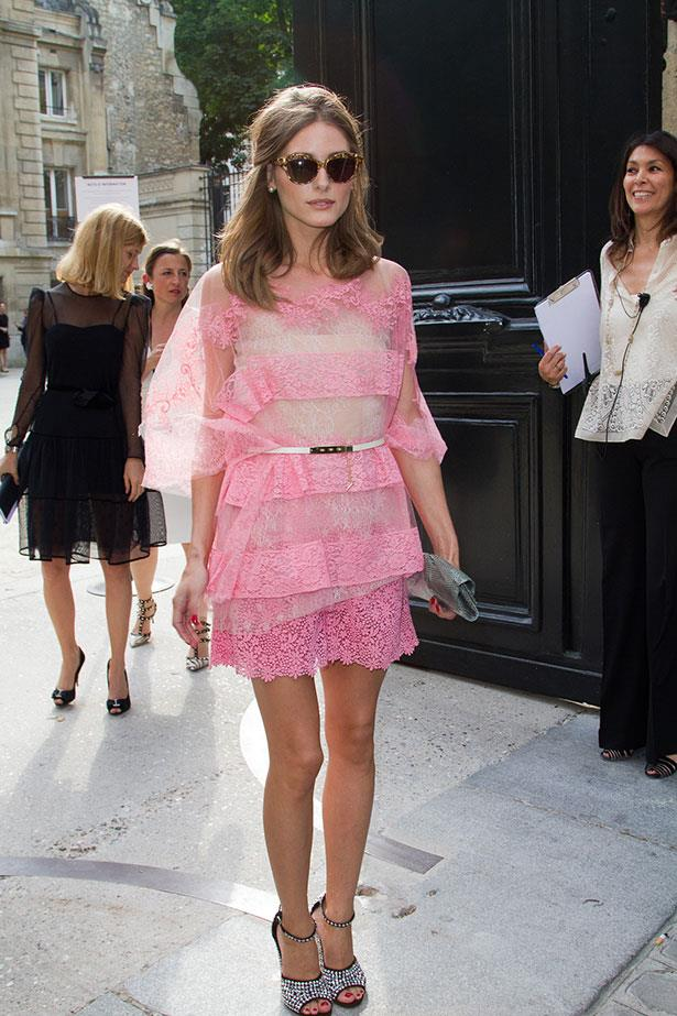 Palermo took a sartorial risk in this vivid pink lace dress and encrusted heels at the Valentino Haute Couture show last year.