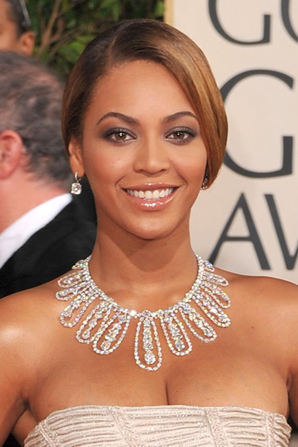Queen Bey sparkles with a sleek, shiny up-do at the Golden Globes in 2009.