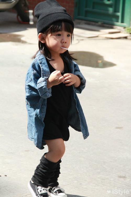 "Beanie? Check. Leg warmers? Check. Lolly pop? Check. This outfit is Aila's take on ""off-duty""."