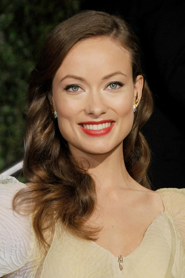 Embracing a classic glam look, Olivia channels Old Hollywood at the 2010 Vanity Fair Oscar Party.