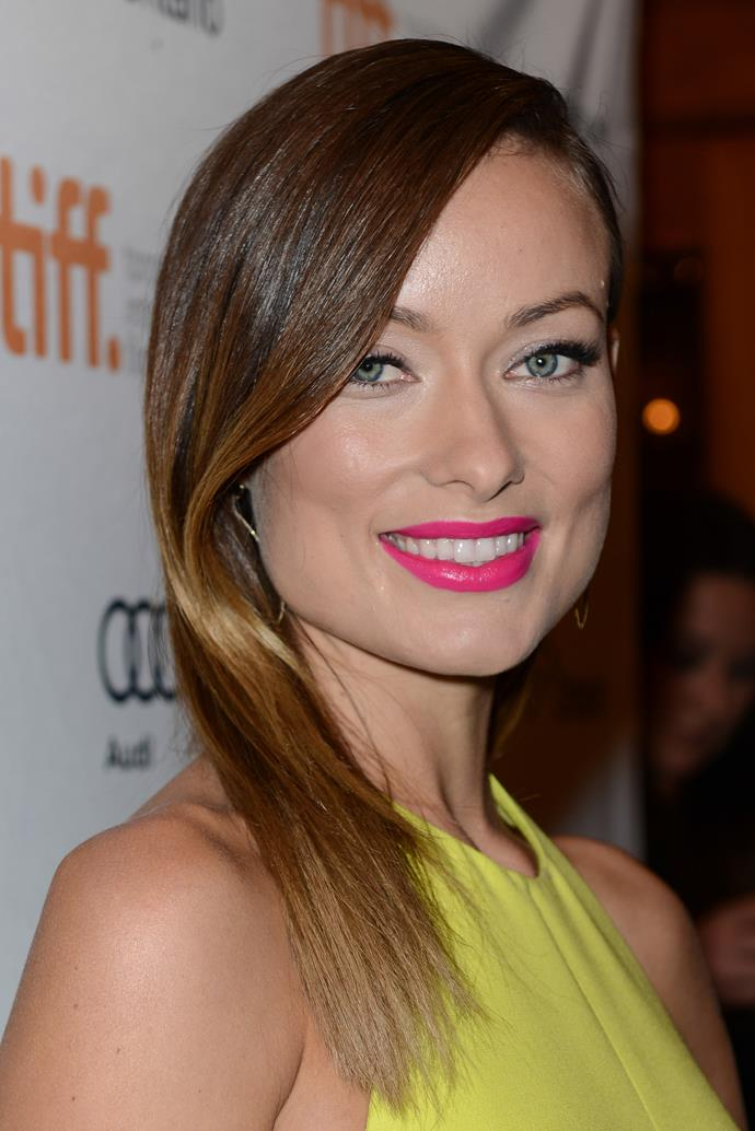 A bright pink lip pops on a blissfully engaged Olivia at the 2013 Toronto premiere of her new movie 'Third Person'.