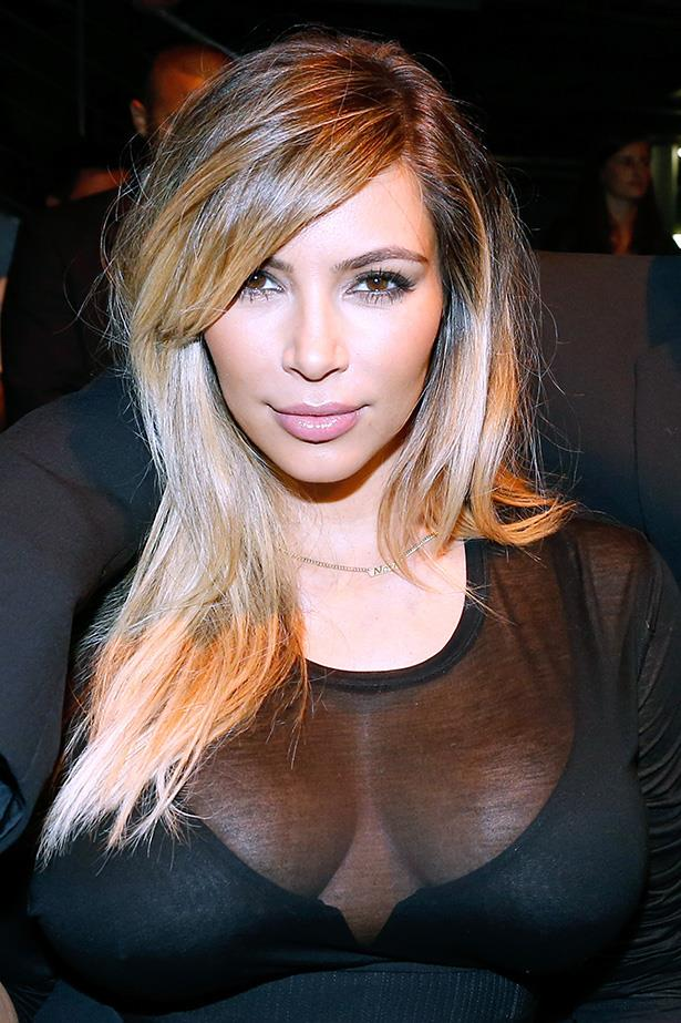 Kim Kardashian has emerged from her maternity hiatus and debuted her blonde locks at Paris Fashion Week.
