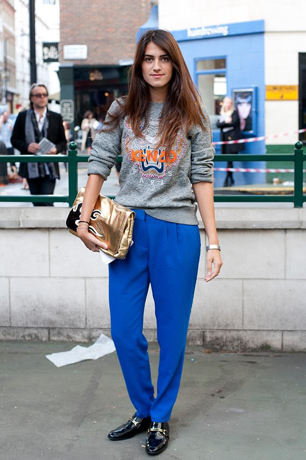 A Fashion Week goer teams her speckled grey Kenzo knit with cobalt blue trousers and man-style loafers.