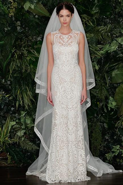 From the A/W14 Bridal Collections, this beautiful Keem Khan gown's interesting neckline and body-con shape would have been a gorgeously demure choice for the usually cleavage-baring Kim.