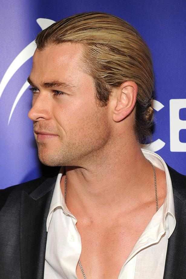 From a time when Chris Hemsworth had longer hair. He's just recently lobbed off his mane and is sauntering around Hollywood without his signature knot.
