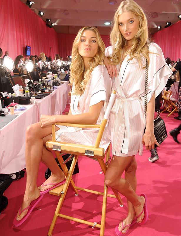 Australian Jessica Hart and Elsa Hosk pose for the cameras backstage
