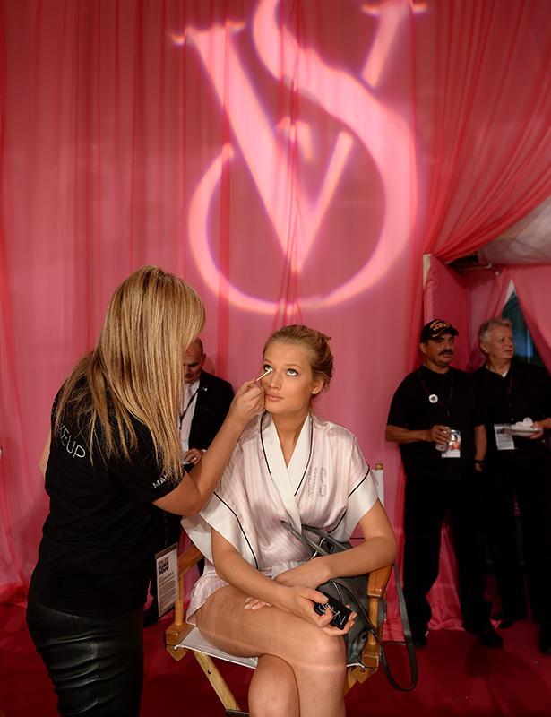 VS model having her make-up touched up backstage