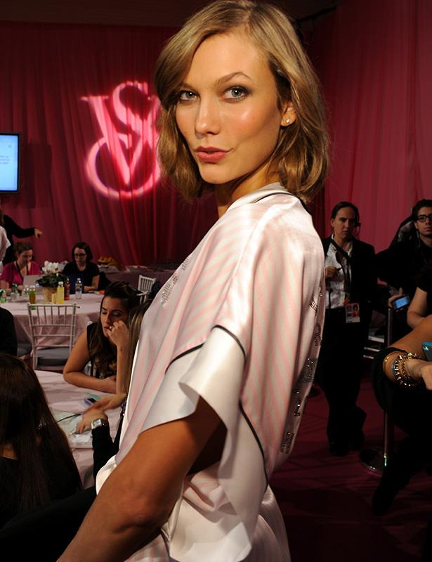 Karlie Kloss pouts for the cameras backstage