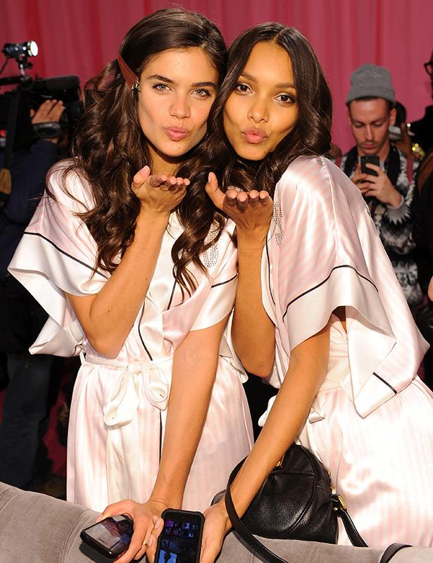 Models Sara Sampaio and Lais Ribeiro prepare at the 2013 Victoria's Secret Fashion Show