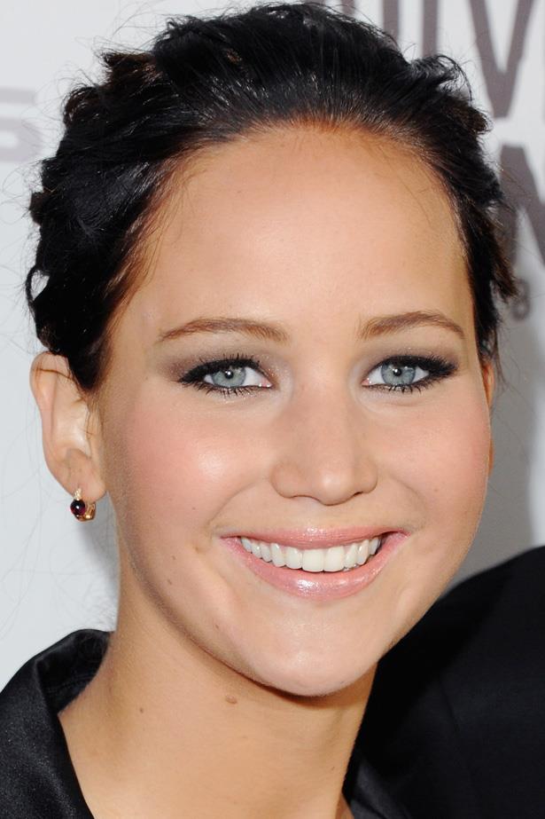 A darker hued, slicked back 'do makes Jen's bright blue eyes shine.
