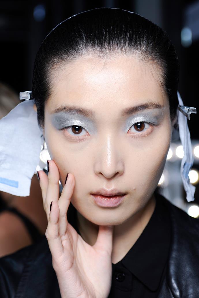 Brow-reaching silver metallic eye shadow is the ultimate glam companion.