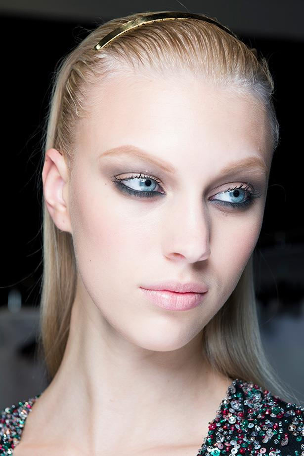 This beauty look is focused on the smudged lower lash kohl liner. Balance with grey shadow on the lid and finish with a flawless complexion and nude lip.