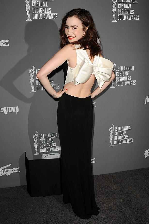 <p><strong>Most elegant display of midriff</strong></p> <p><strong>Lily Collins</strong></p> <p>Never mind the old-school grace, those abs deserve a trophy all to themselves.</p> <i>Image: Wearing Paule Ka at the 15th Annual Costume Designers Guild Awards.</i>