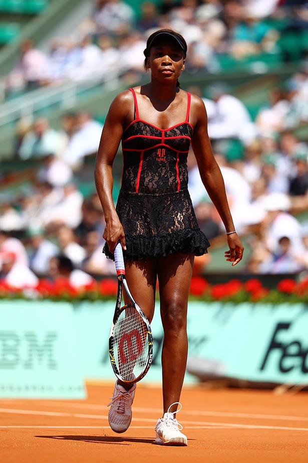 No this isn't the banned costume, but we won't judge you if you thought it was. Venus Williams may have simply rolled out of bed still wearing her lace skirt and red bustier, slipped into her trainers and onto the court in 2010.
