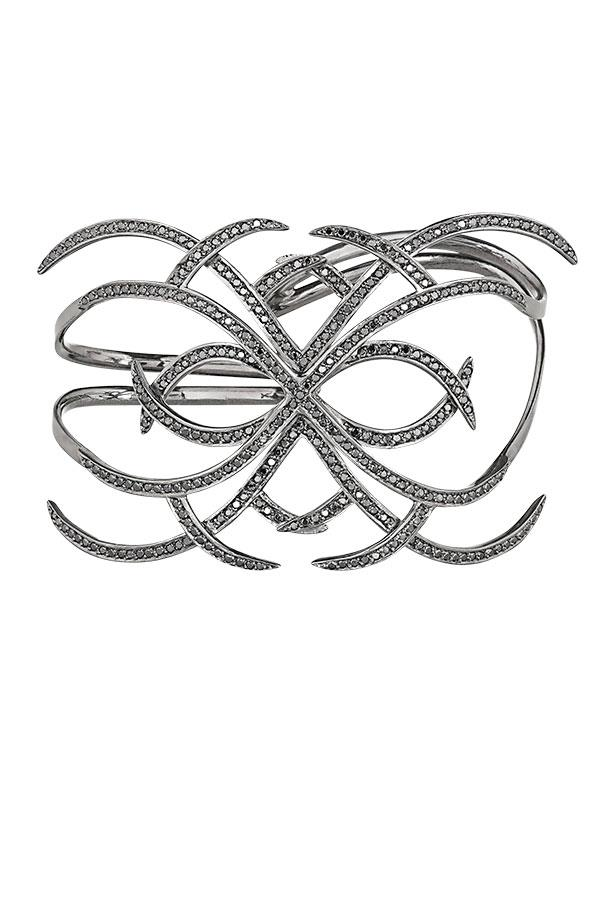 """<p>New York jeweller Ana Khouri's black diamond arachnid cuff is primed and ready to be snapped up by Madonna, already a fan.</p> <p>Hand cuff, approx $39,700, Ana Khouri, <a href=""""http://www.net-a-porter.com"""">net-a-porter.com</a></p>"""