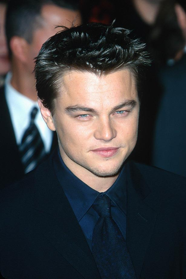 By 2000, DiCaprio had his red carpet sultry squint down-pat, debuting the beginnings of facial fuzz on his chin.